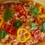 Authentic Mexican style Rice with colorful pepper rings on top.
