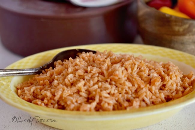 A yellow bowl filled with Authentic Mexican Style Rice.