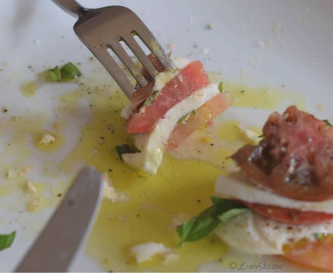 A perfect bite of caprese salad.