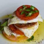 Heirloom tomatoes, mozzarella, olive oil, and fresh basil leaves make this simple salad delicous.