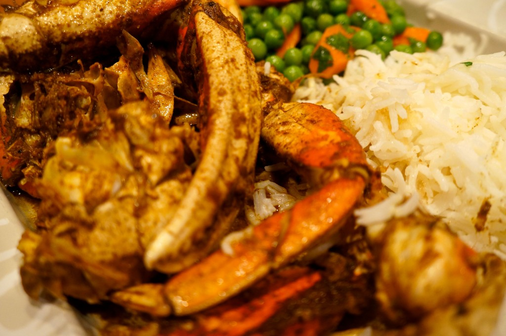 Moroccan Dungeness Crab Tagine served up with rice and peas