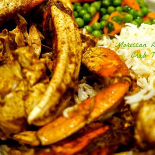 Moroccan Dungeness Crab Tagine served on a plate with basmati rice.