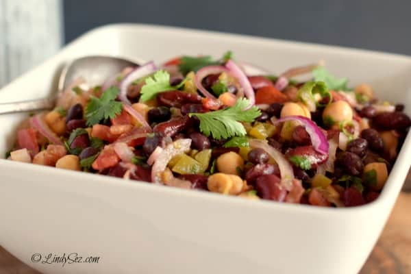 Low-Fat Spicy Mexican Style 3-Bean Salad white bowl gray background