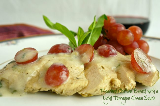 Poached Chicken Breast with a Light Tarragon Cream Sauce on a plate with garnishes.