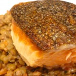 Salmon with lentils and bacon.