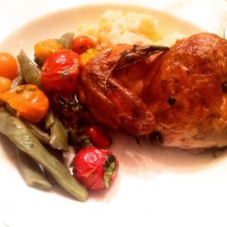 Rosemary Smoked Cornish Game Hens on a plate with vegetables