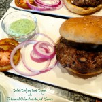 Sirloin Beef and Lamb Burgers with Feta and Cilantro Mint Sauce on plate