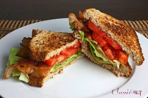 A classic BLT on a white plate.