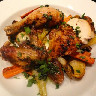 A plate of Simple roasted chicken with quick roasted root vegetables.