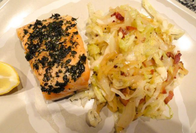 Slow baked salmon fillets with bacon braised cabbage.