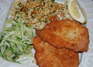 Wiener Schnitzle served with zucchini spaghetti .