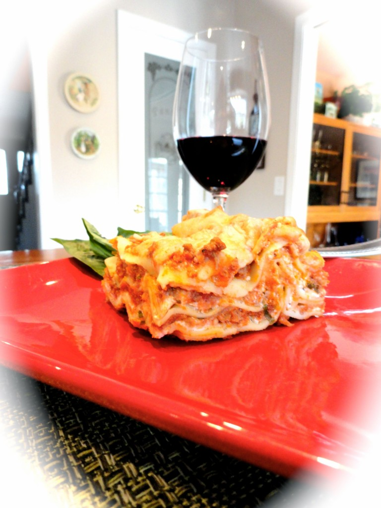 vegetable lasagna with a glass of wine