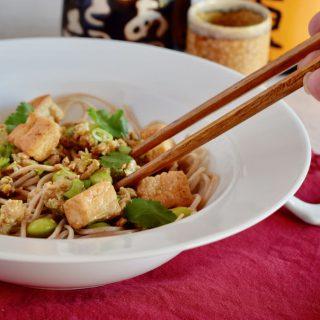 Chopsticks being used to eat some Ma Po Tofu.