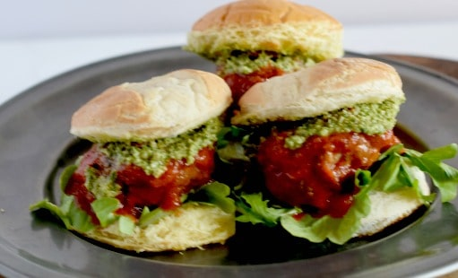 A plate of meatball sliders showing all the tasty toppings.