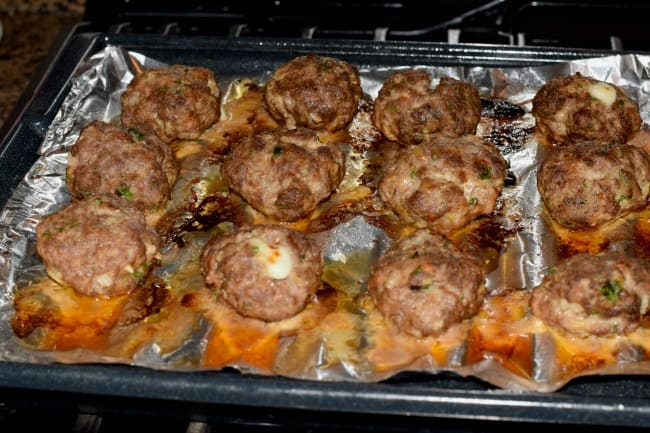 Fresh from the broiler, meatball sliders ready to assemble.