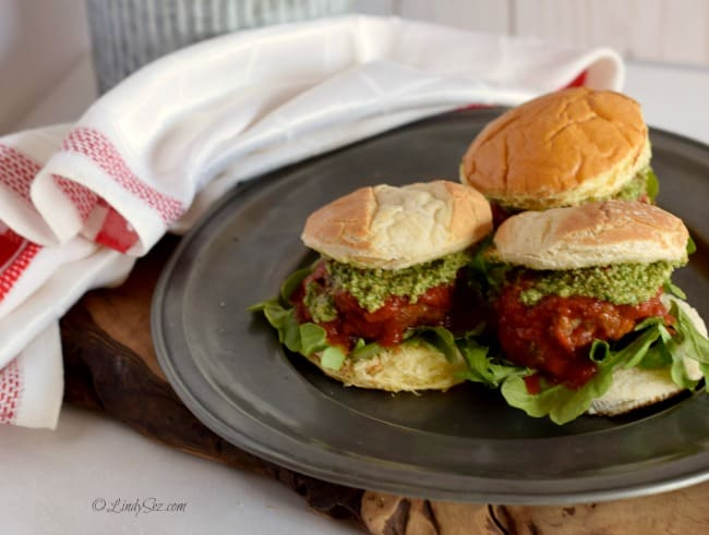 Meatball Slider on a platter with a white towel in the background.