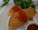 a serving of Turkey Meatloaf with Roasted Tomato and Red Pepper Sauce