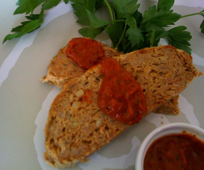 A serving of Turkey Meatloaf with Roasted Tomato and Red Pepper Sauce.