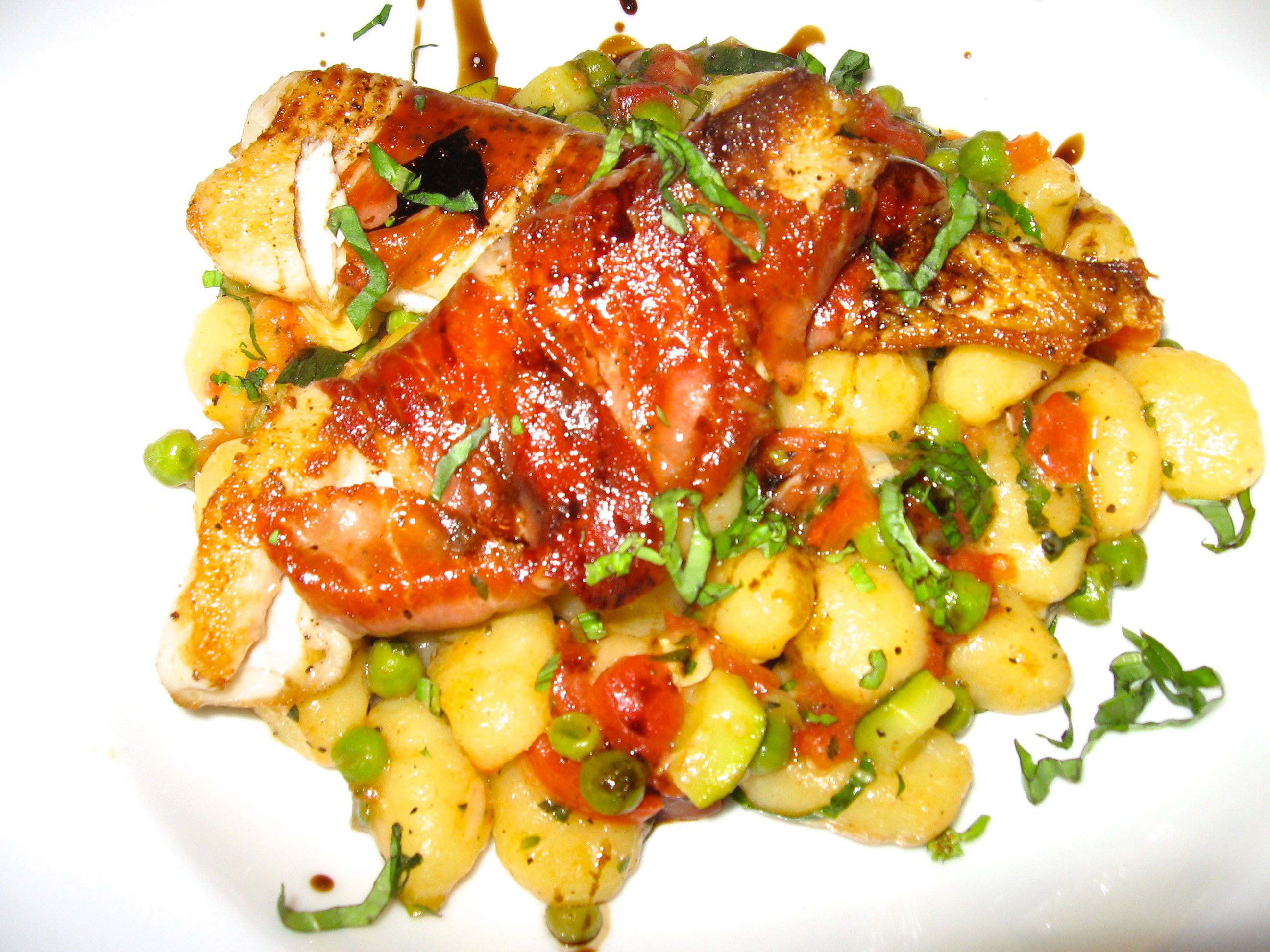 Prosciutto Wrapped Tilapia served over Gnocchi with Spring Vegetables