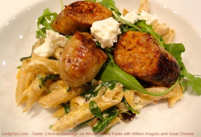 Garlic Chicken Sausage on Whole Wheat Pasta with Wilted Arugula and Goat Cheese