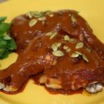 Chicken Mole Tradicional on a yellow plate