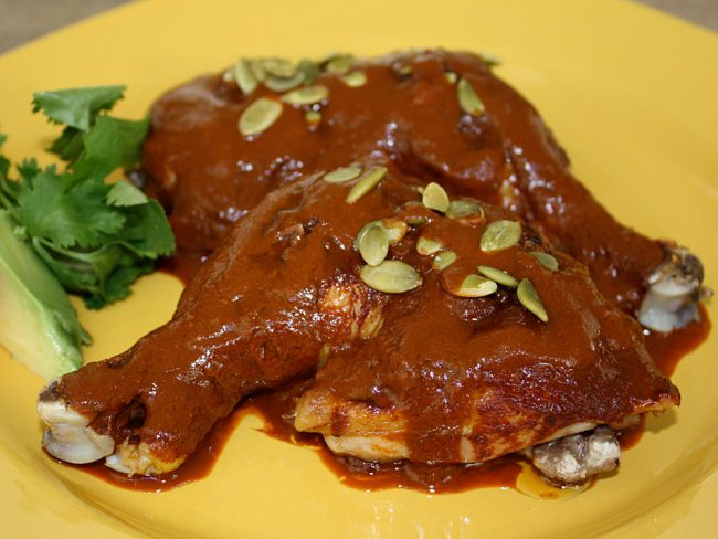 Chicken Mole Tradicional on a yellow plate