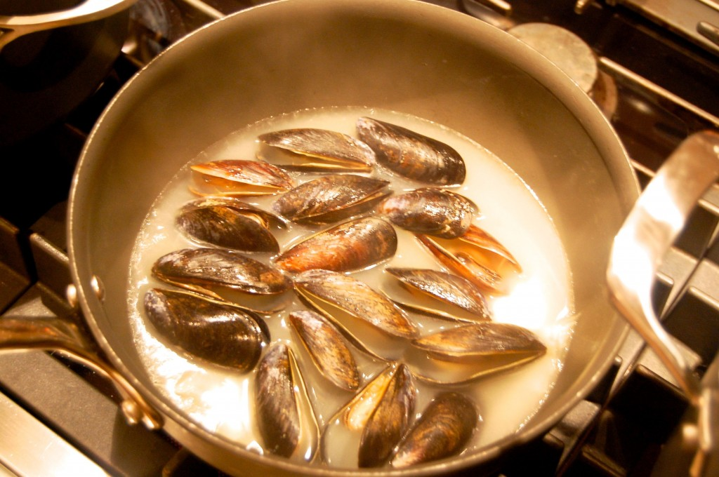 mussels simmering in broth