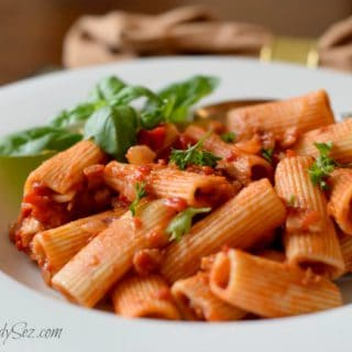 A bowl of Rigatoni with Roasted Peppers, Tomatoes and Pancetta