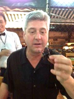 Brian Baker eating scorpion in Thailand