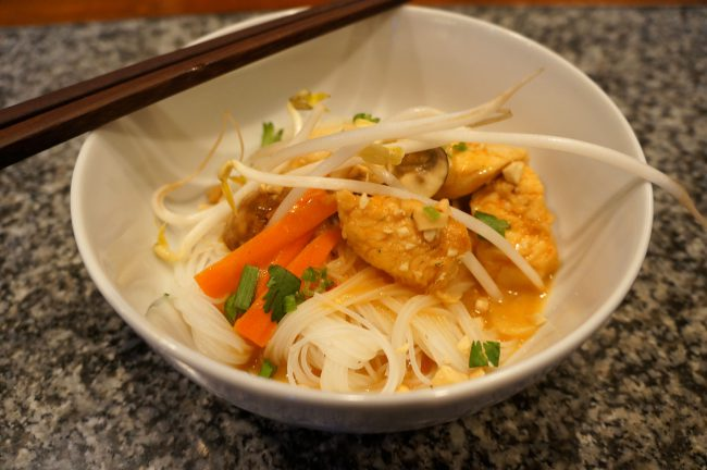 thai chicken with saucy rice noodles
