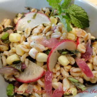 Farro Salad in a bowl with garnish.