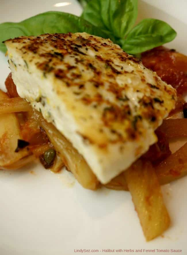 A plate with a piece of halibut on top of fresh tomato fennel sauce.