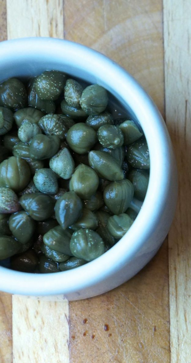 a bowl of capers as used in Baked Swordfish with Olive Relish