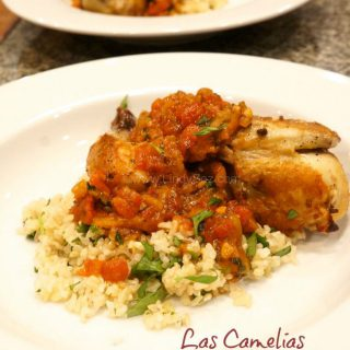 Las Camelias Cornish Game Hens served in a white bowl