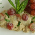 Poached Chicken Breast with a Light Tarragon Cream Sauce with grapes.