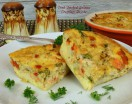 crab and smoked salmon crustless quiche with cute salt and pepper shakers
