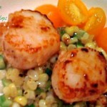 fresh corn with seared scallops on a plate