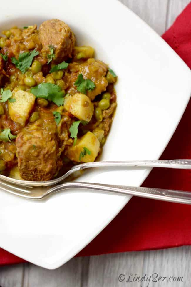 Tagine of Pork with Sweet Potato and Ras-el-hanout on white dish