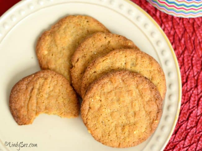 almond butter cookie your way thin on plate with red background