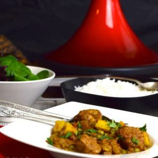 Tagine of Pork with Sweet Potato and Ras-el-hanout with a tagine