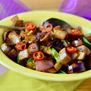 Quick Spicy Thai Style Eggplant in a yellow serving dish.