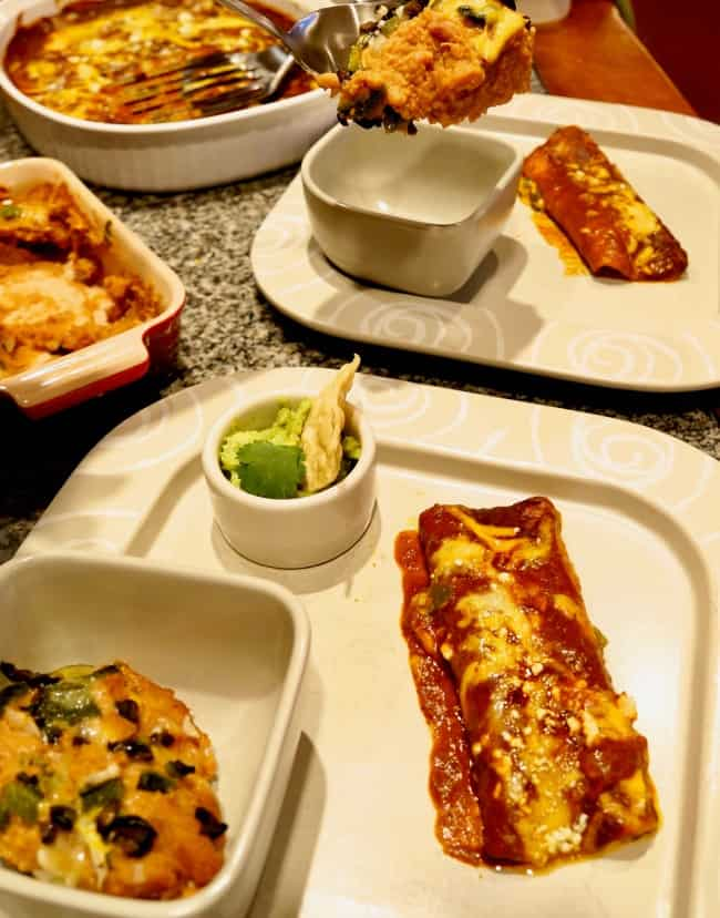 a plate of loaded cheese enchilada