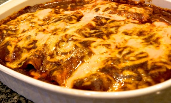 a finished casserole of fully loaded cheese enchilada