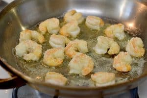 Perfectly cooked shrimp in a pan.