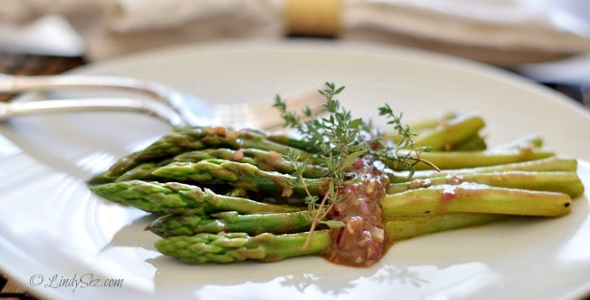 Asparagus Salad with Balsamic Dressing on a plate with forks