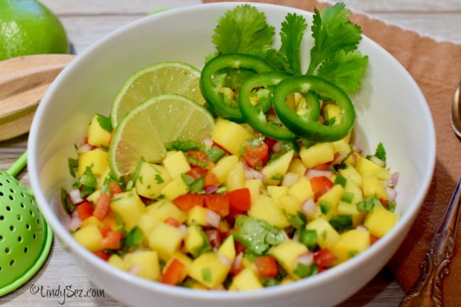 A bowl of mango salsa waiting to be put on some curry snapper