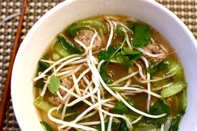 Quick Pho with Ginger Pork Meatballs complete in a white bowl