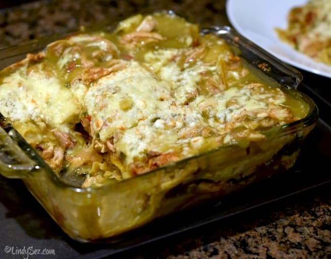 a casserole dish with Green Chili Chicken Enchilada Stack in it