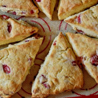 Freshly baked strawberry cream scones on a silpat.
