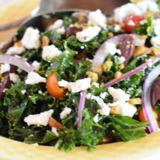 An overhead view of massaged kale Greek salad